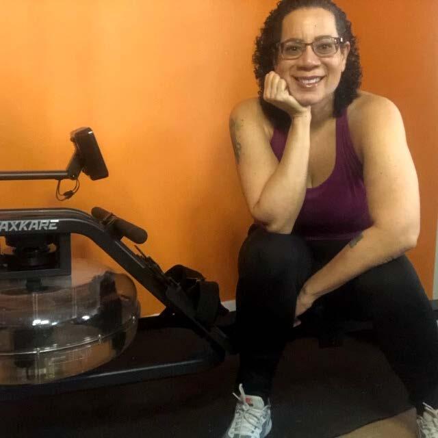 Jill Hodge sitting on rowing machine